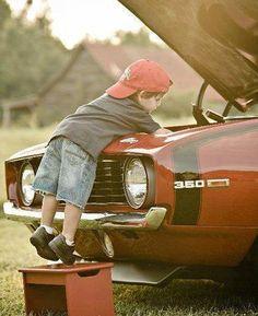 kid working on '69 Camaro SS